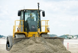 High-speed dozer pushing dirt