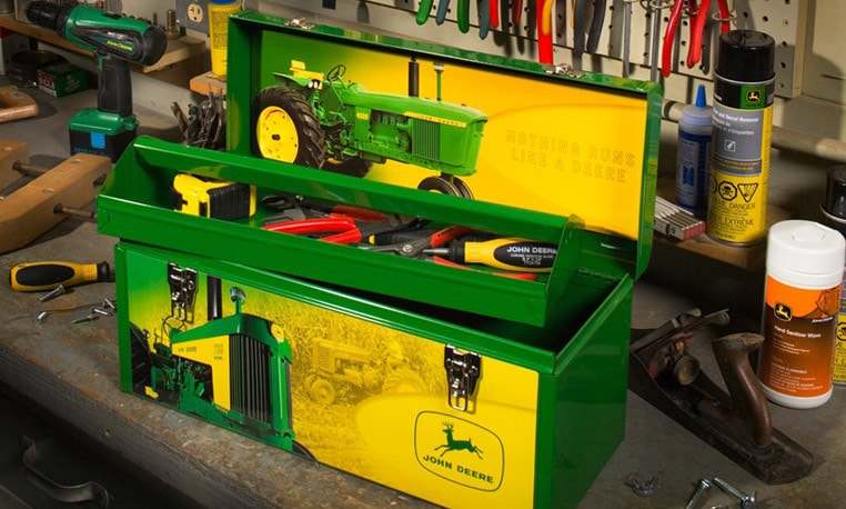 John Deere toolbox filled with tools sitting on a workbench