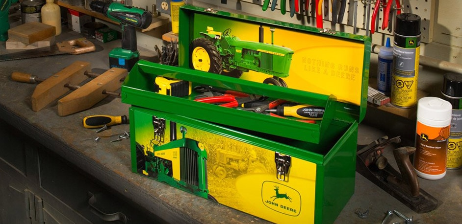 John Deere toolbox with John Deere tools on a toolbench