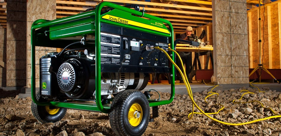 John Deere Portable Generator outside with a building under construction in the background