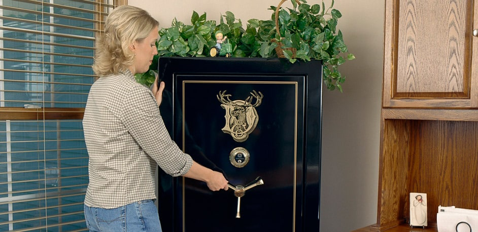 woman opening a John Deere security safe in an office