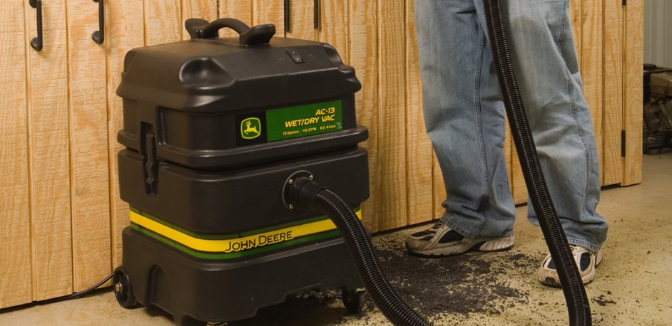 AC-13 13-Gallon Wet/Dry Vacuum being used to clean workshop bench