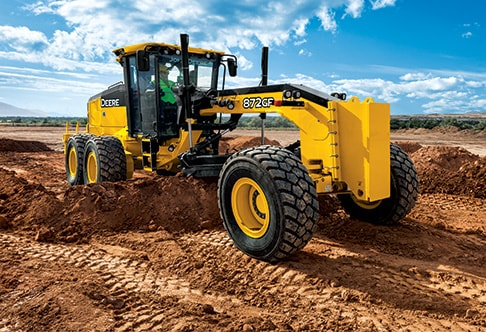 Right side view of an 872GP Motor Grader doing heavy dirt work