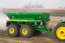 DN345 Drawn Dry Spreader working in a dusty field