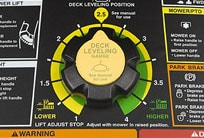 Close-up image of mower deck height adjustment dial