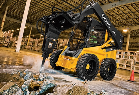 318E Skid Steer with a Worksite Pro Hydraulic Breaker attachment