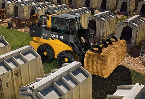 318E Skid Steer with a Worksite Pro Utility Grapple attachment