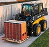 320E Skid Steer with a Worksite Pro Pallet Fork attachment