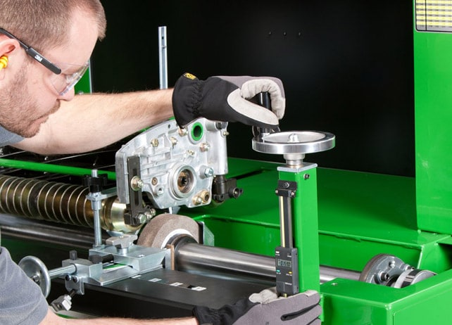 Technician using RG5500 Semi-Automatic Spin and Relief Reel Grinder