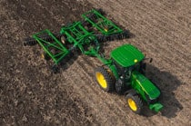 Overhead view of John Deere tractor with tillage equipment working in a field
