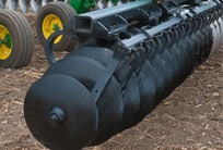 Closeup of heavyweight spherical disk blades on John Deere tillage equipment