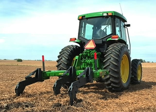 John Deere tractor with 913 V-Ripper working in a field
