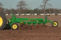Closeup of the 995 Reversible Plow working in a field
