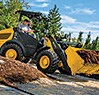 304K Compact Loader with bucket full of mulch