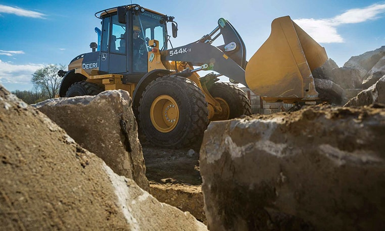 John Deere 544K-II Wheel Loader moving rocks on a jobsite