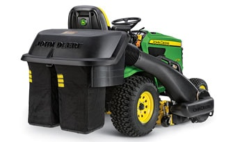 Photo of John Deere riding mower with a material collection system installed