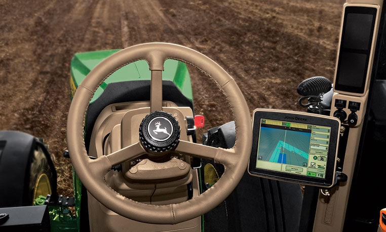 Image of cab of tractor using guidance and linking to guidance video