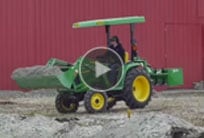 Tractor with loader and box blade
