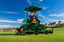 Man driving an 8700 Precision Cut A Models on golf course turf
