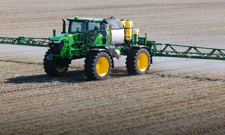 John Deere self-propelled sprayer working in a field