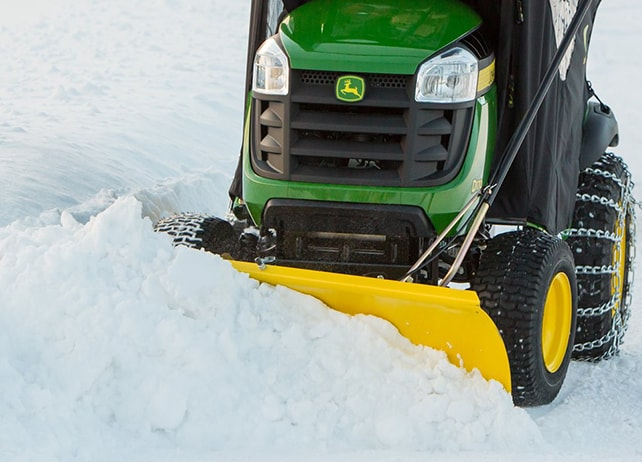 D170 lawn tractor with enclosure in snow