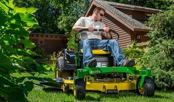 Man riding a Ztrak Mower