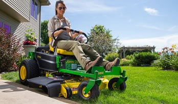 Woman enjoying the new residential ztrak Z300 mower