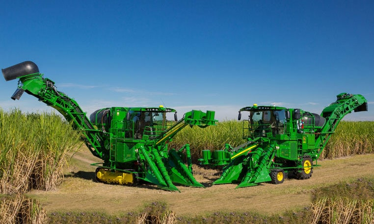 Image of a track and wheel sugar harvester