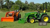 ESeries Tractor and Kubota Tractor in a field