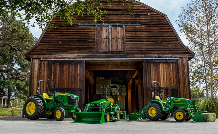 Image of e-series tractors in front of barn