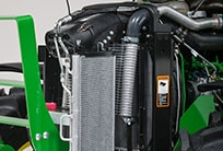 Close-up image of easy clean cooling package under hood of tractor