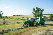 6E Utility Tractor with baler in field
