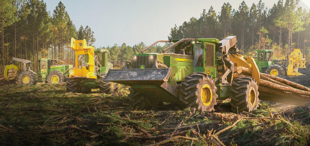 John Deere forestry equipment in a forest