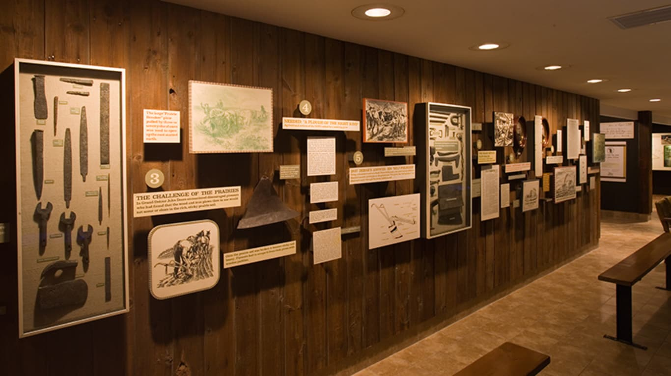 A variety of wall exhibits on display at the John Deere historic site