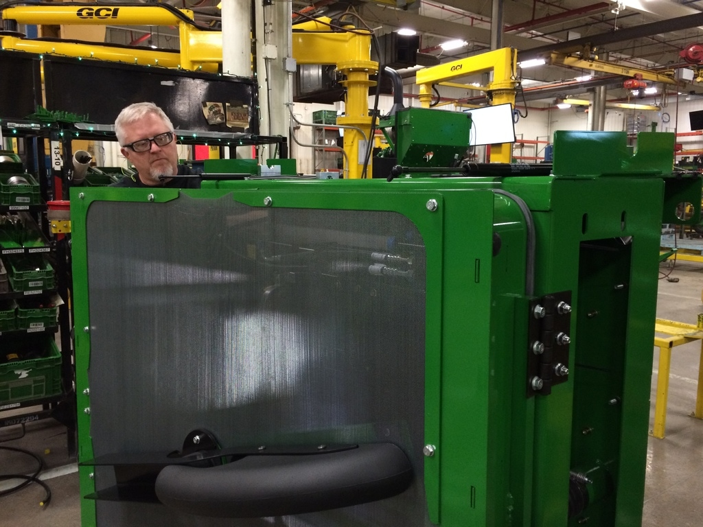 A John Deere worker on the factory floor