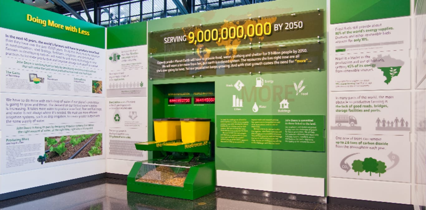 An informational display sits on the floor of the John Deere Pavilion