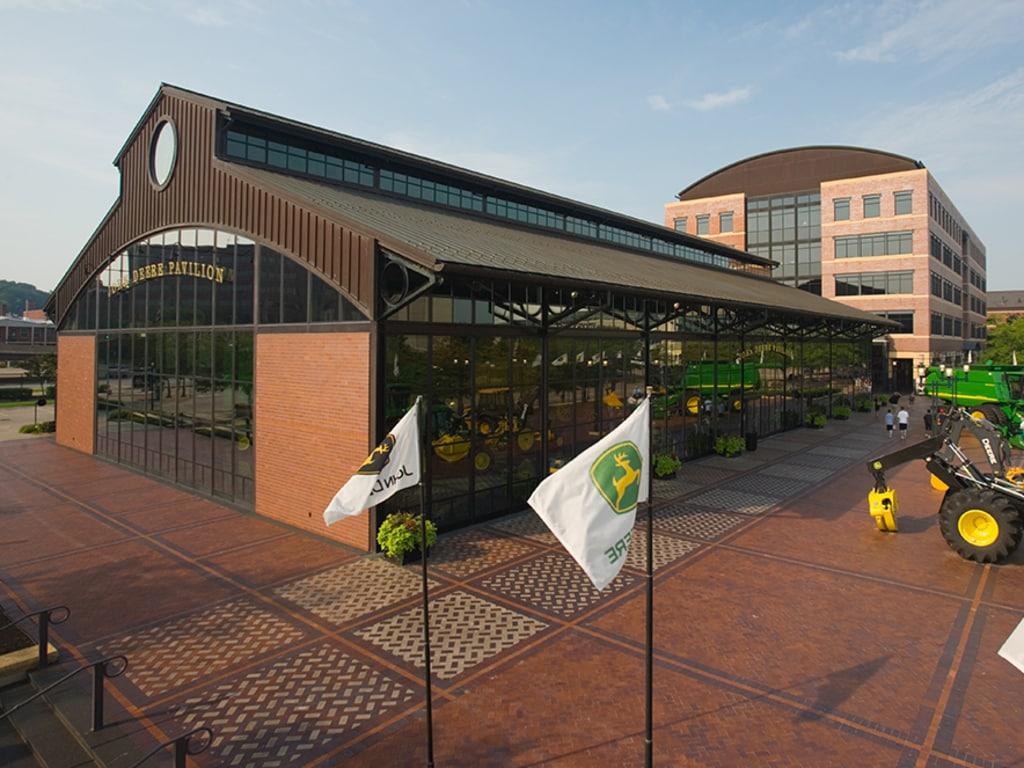 An outdoor view of the John Deere pavilion and its surroundings