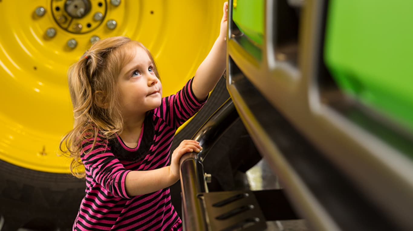 A little girl gets up close and personal with one of the big machines