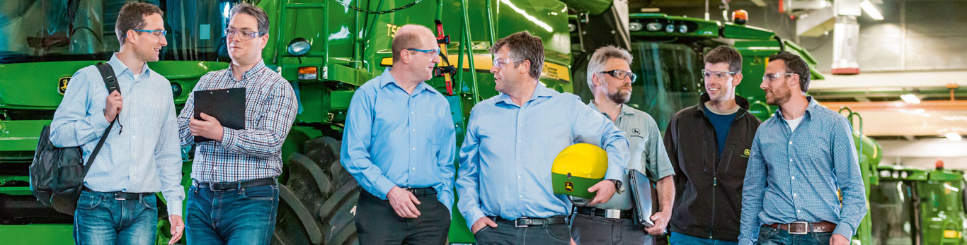 Image of men walking through John Deere factory