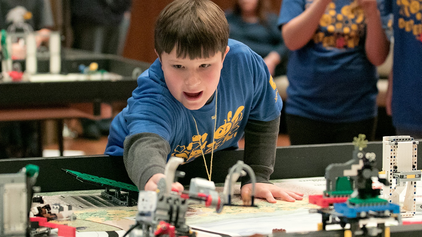Kids participating in the first Lego League Event at the Deere & Company Headquarters