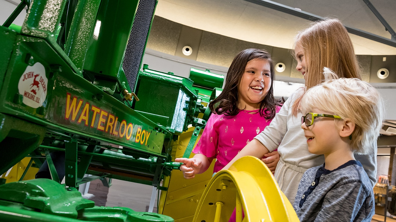 Children looking at a Waterloo Boy Tractor on display