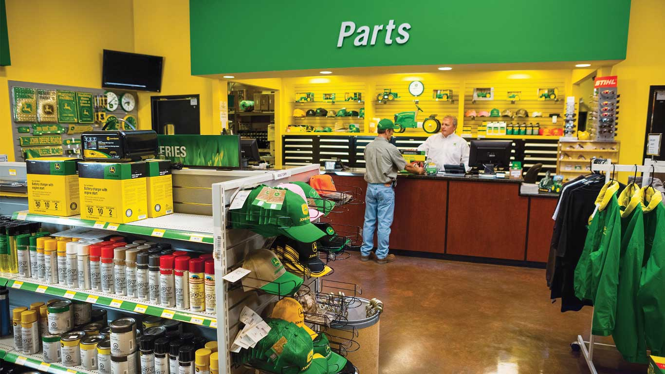 A John Deere dealer helping a customer