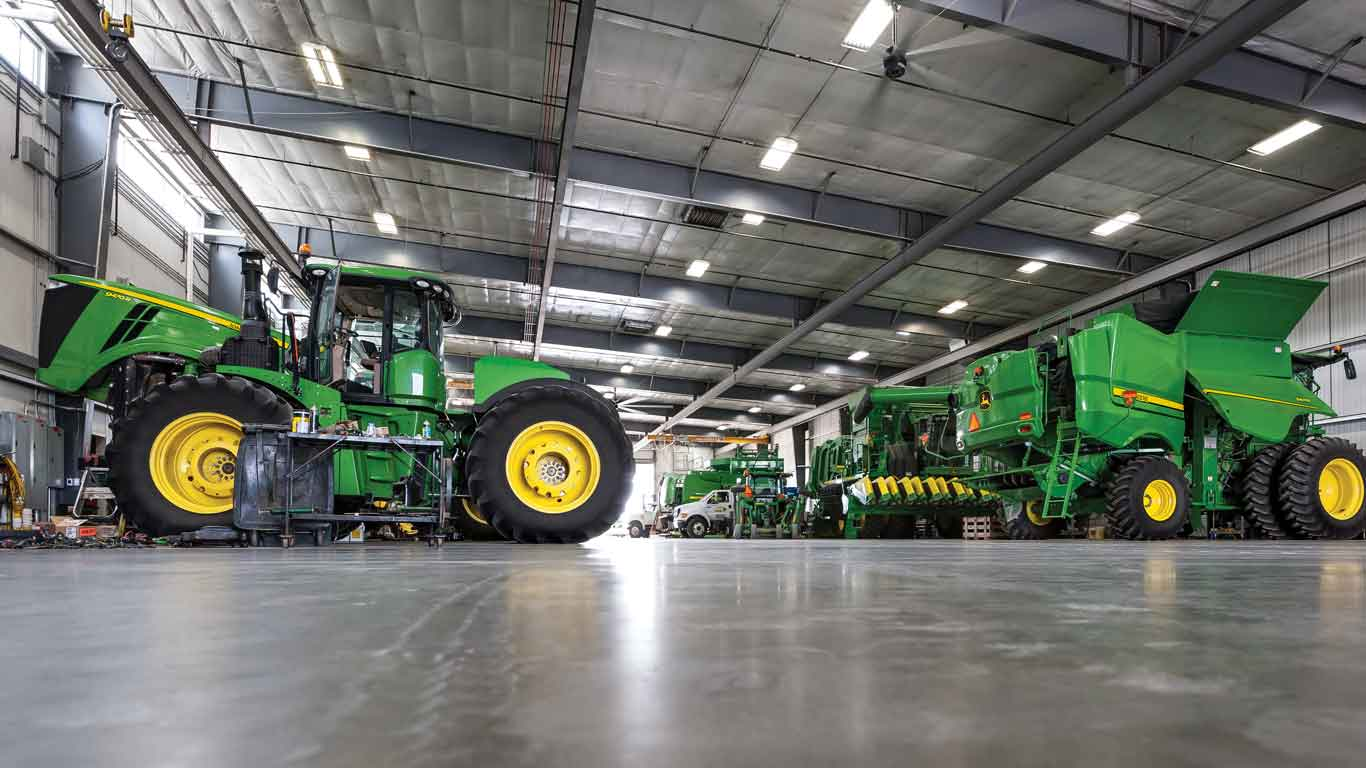 John Deere Tractor and Combine in a warehouse