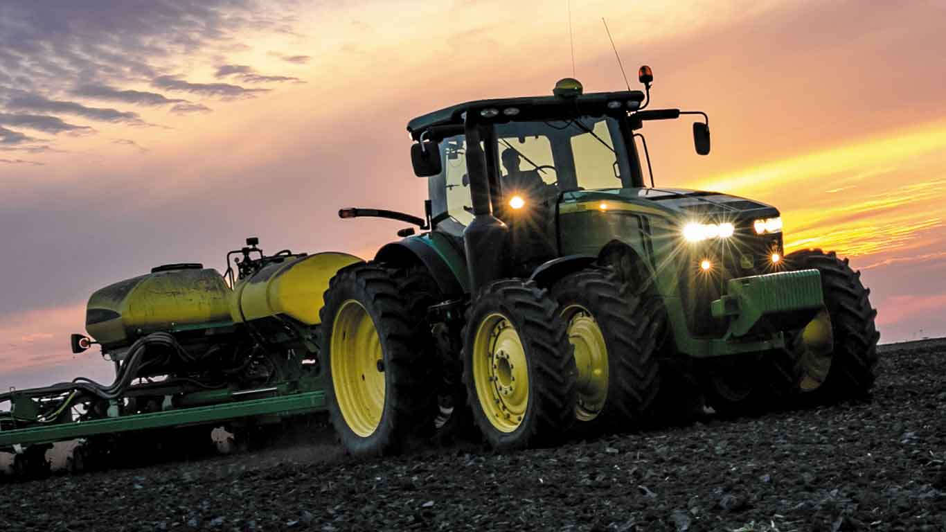John Deere Tractor in a field during sunset
