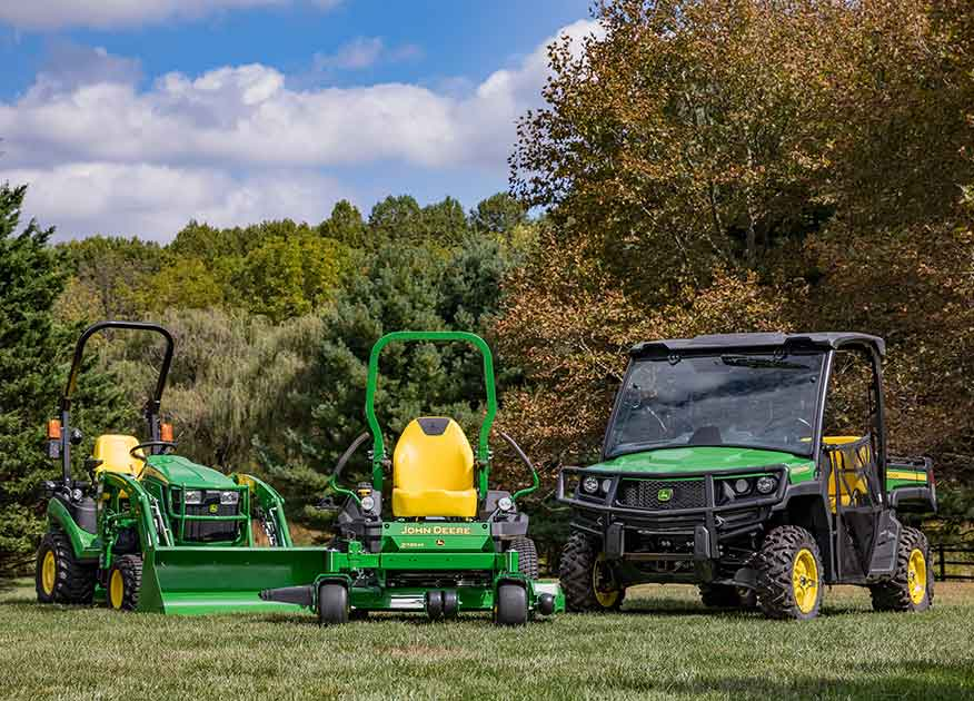Line up of John Deere Landscaping & Grounds Care Equipment on grass