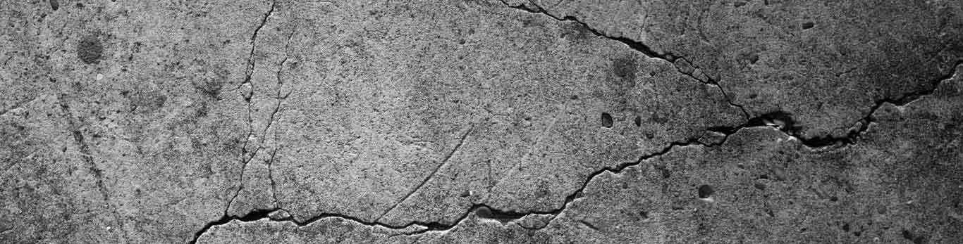 Close up of cracked concrete ground