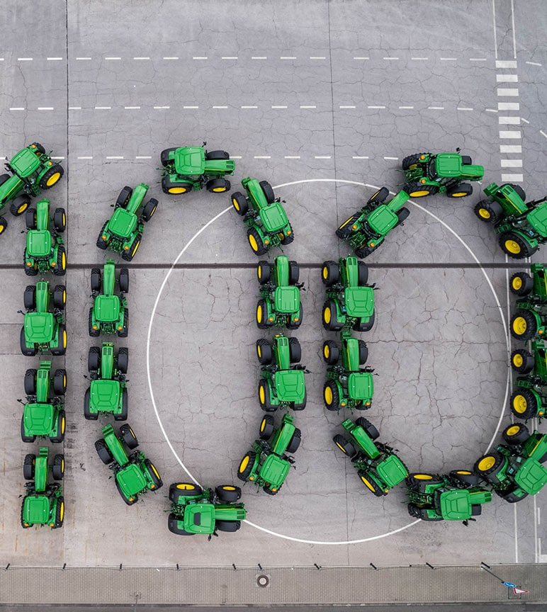 Multiple tractors for the shape of the number one hundred.