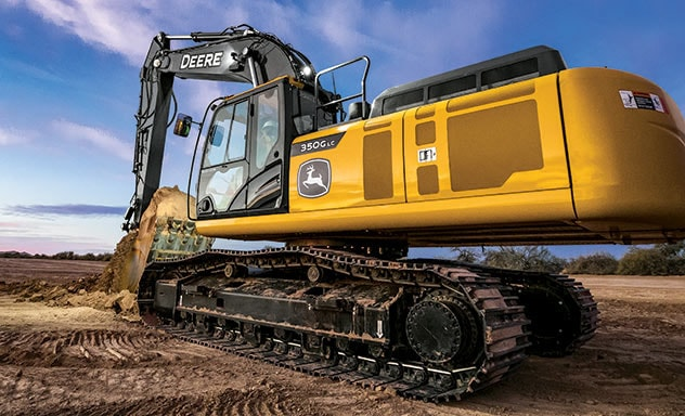 350G LC SmartGrade Excavator scoops a load of dirt.