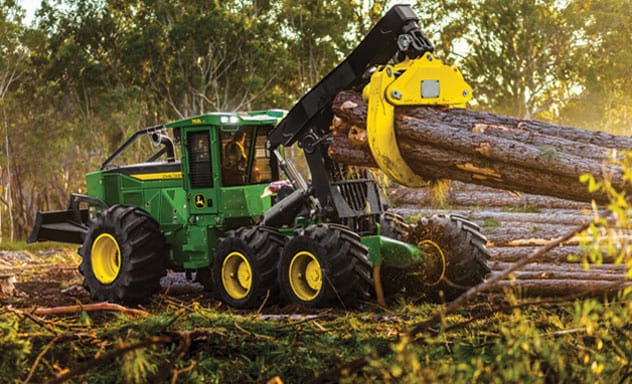 Skidder moving trees a the forest work site.
