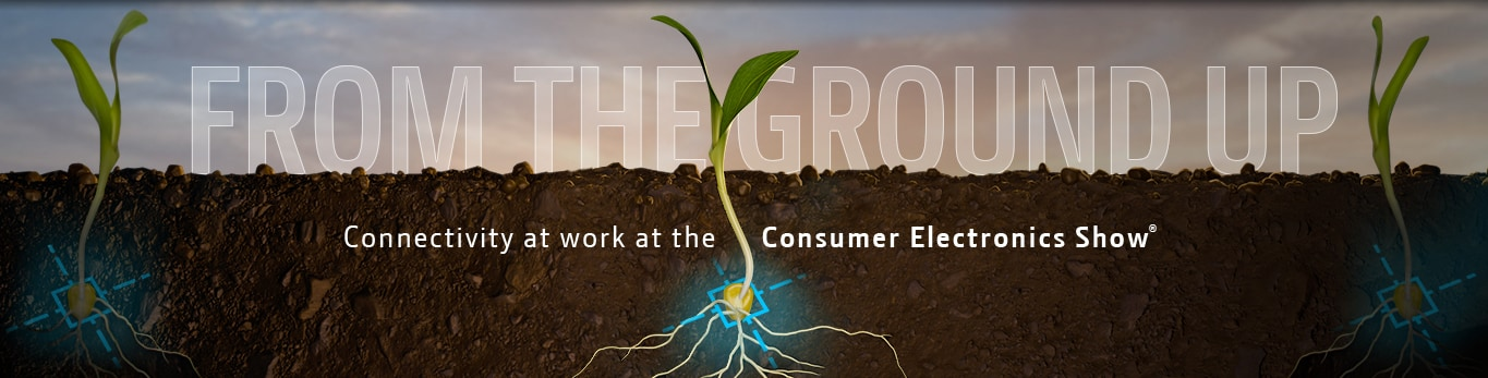 Graphic of plant sprouting up through dirt with blue holograph around the seed. Text says 'From the Ground Up. Connectivity at work at the Consumer Electronics Show'.